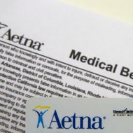 An Aetna benefits card and medical information.