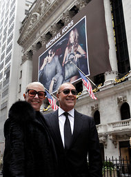 Michael Kors and his mother in front of the New York Stock Exchange.