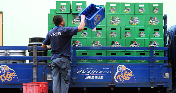 Heineken and Thai Beverage are both attempting to buy Fraser  Neave's beer unit, whose brands include Tiger Beer.