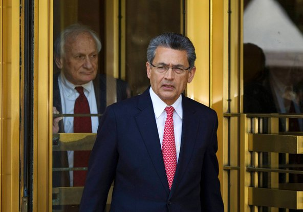 Former Goldman Sachs board member Rajat Gupta (R) leaves Manhattan Federal Court with his lawyer, Gary Naftalis, following a guilty verdict.