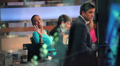 Robin Roberts waved to fans outside the Good Morning America studio on her first day back at work following a bone marrow transplant.