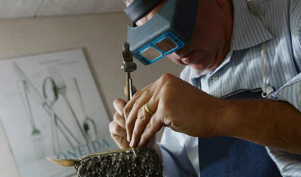 Bill Croll, an Oneida designer, works on a prototype for a sterling spoon.