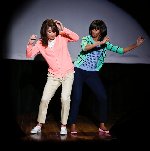 """Michelle Obama with Jimmy Fallon, in a wig, performing """"The Evolution of Mom Dancing,"""" which has become a YouTube hit."""