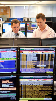 Mac Budd, left, and Rich Bryant watched markets on Bloomberg terminals for MF Global before the firm's collapse. Bloomberg lost nearly $1 million a month in revenue when MF Global failed.