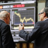 Traders at the bourse in Madrid on Tuesday.