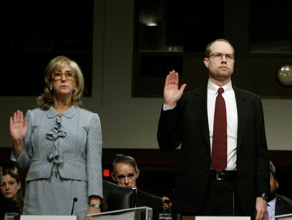 Ina Drew and Peter Weiland swear in before testifying at a Senate inquiry on JPMorgan's trading loss.