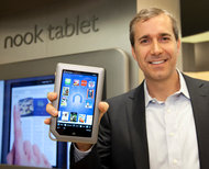 William Lynch, Barnes  Noble's chief executive, shows off the Nook tablet at a bookstore in Manhattan.