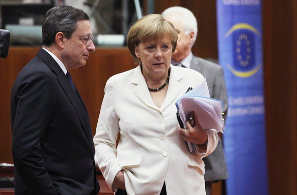 Mario Draghi, the president of the European Central Bank, with the German chancellor, Angela Merkel, at an E.U. summit meeting in Brussels in June.