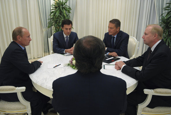Clockwise from left, Russian President Vladimir Putin; an unidentified interpreter; Carl-Henric Svanberg, the chairman of BP; Robert Dudley, BP's chief executive; and Igor Sechin, the Rosneft chairman. The officials met on Tuesday at the Black Sea resort of Sochi.