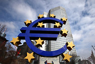 A euro sign sculpture in front of the European Central Bank's headquarters in Frankfurt, Germany.