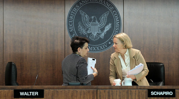 Mary L. Schapiro, right, and Elisse B. Walter at a meeting of the Securities and Exchange Commission last year.