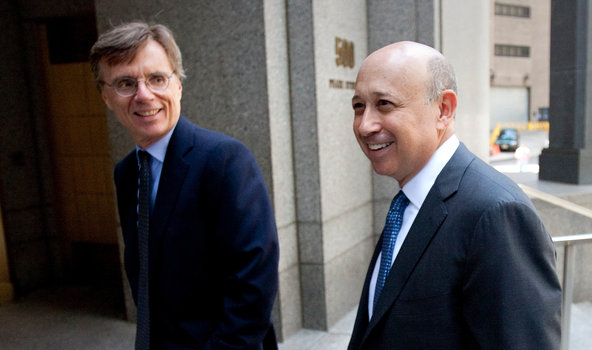 Lloyd Blankfein, chief executive of Goldman Sachs, arriving at federal court on Thursday with Gregory Palm, Goldman's general counsel, at left.