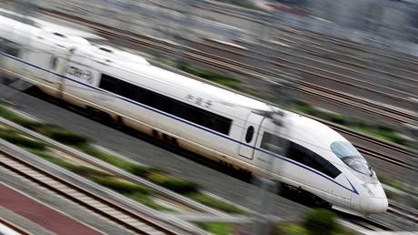 A China Railway High-speed bullet train runs towards Beijing South Railway Station ©Jason Lee