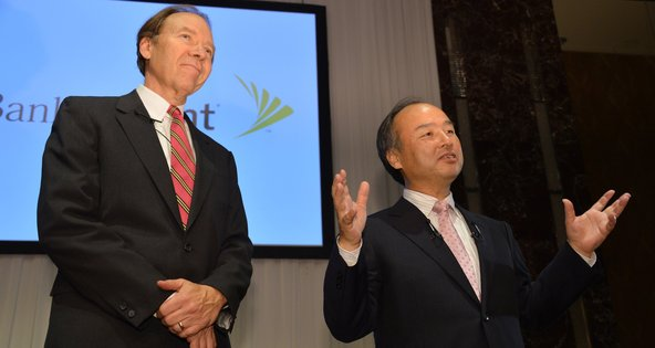 Daniel Hesse, left, the chief of Sprint Nextel, and Masayoshi Son, the president of SoftBank, announced the deal in Tokyo on Monday.