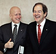 Michael Roach, left, CGI's chief executive, and Serge Godin, the executive chairman, in 2006.