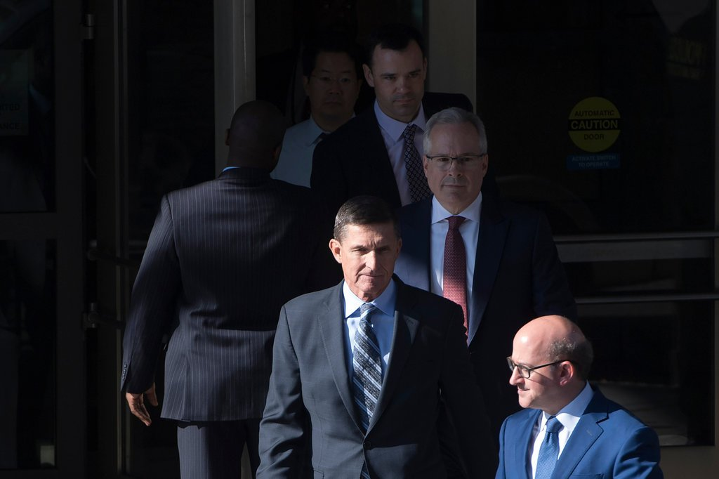 Michael Flynn, center, leaving court in Washington on Friday.