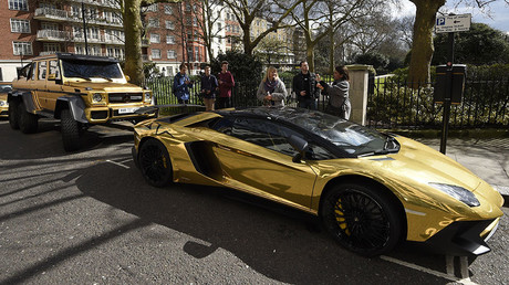 Cars are seen parked on a street in Knightsbridge in London