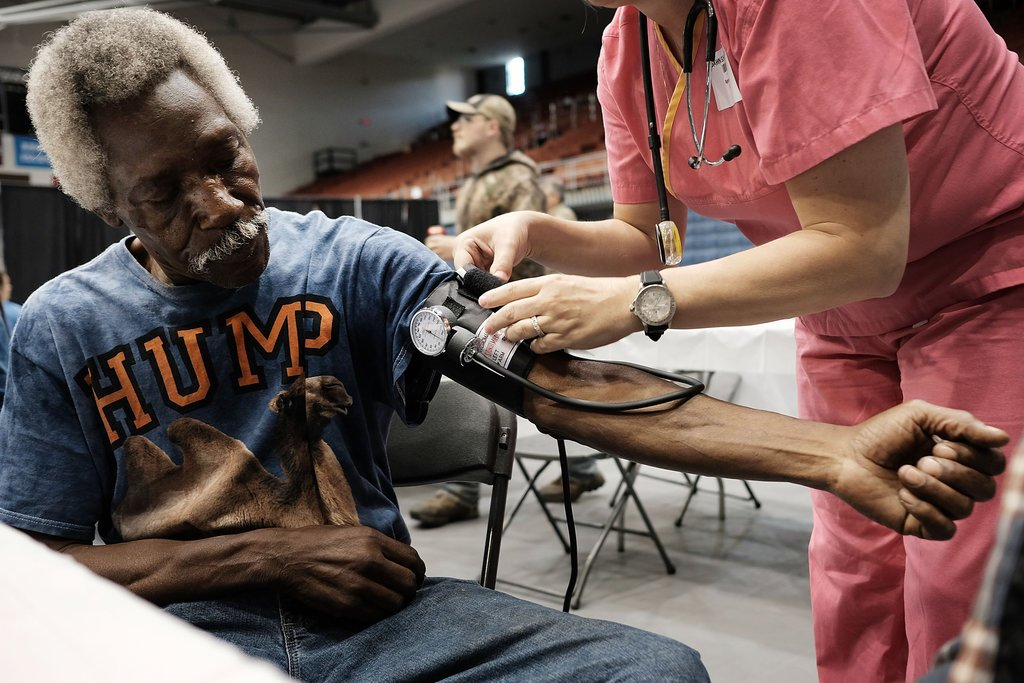 Thyleb Ramadhan got his blood pressure checked at a mobile medical clinic in Olean, N.Y., in June.