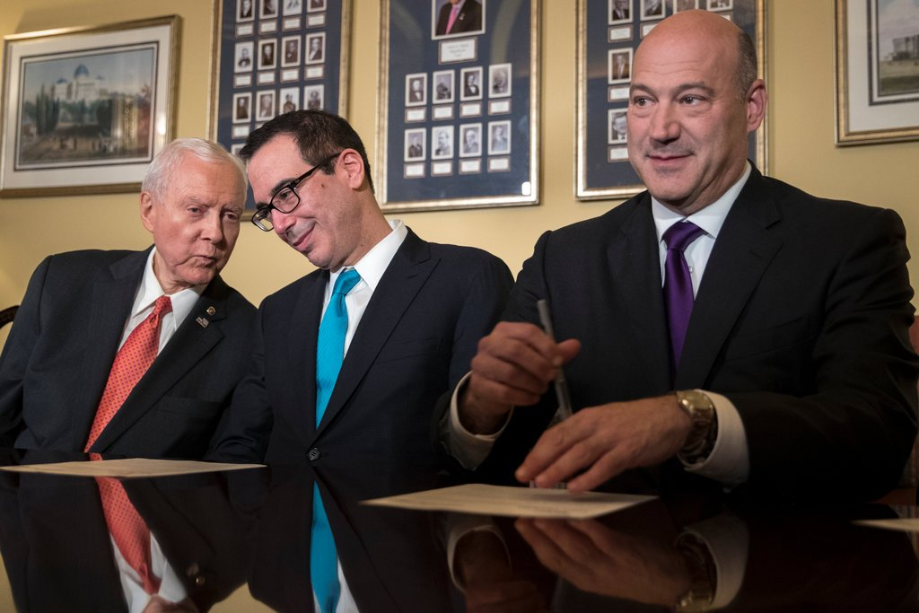 From left, Senator Orrin Hatch, the chairman of the Finance Committee, with Treasury Secretary Steven Mnuchin and Gary D. Cohn, the national economic adviser, gathered for a meeting on tax overhaul legislation at the Capitol on Thursday.
