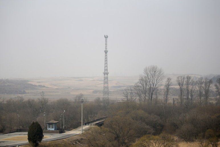 North Korea's surveillance cameras sit atop a steel tower overlooking the South, near the border village of Panmunjom.